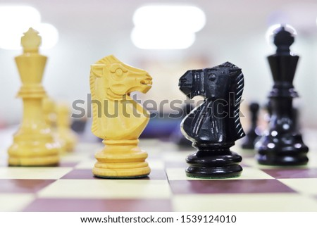 Chess is a strategy game that is played on a square board that is divided into 64 squares with a composition of one king, one minister, two strongholds, two horses, two elephants, and eight pieces. #1539124010
