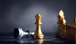 chess piece stand in front of pawn on black background