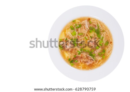 chicken soup with noodle and vegetables. top view. isolated on white #628790759