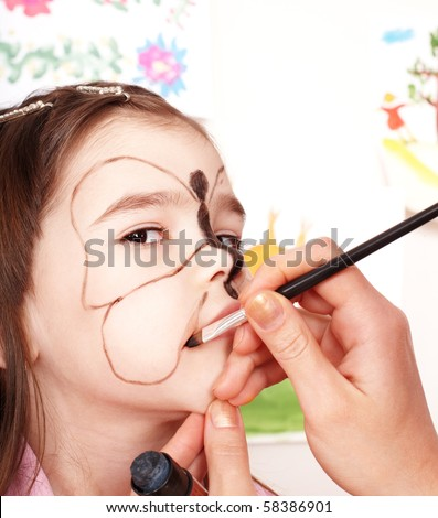 Child with face painting. Make up.