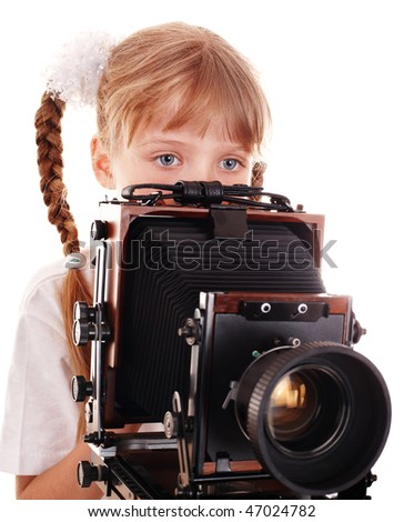 Child with old wood large format camera. Isolated.
