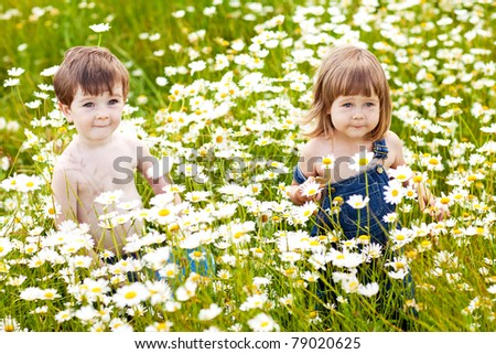 2 children playing outdoors