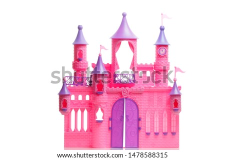 Children's toy plastic pink сastle for dolls isolated on a white background. For a little girl playing a fairytale princess  of the knights times.