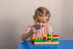 Children's wooden toy. The child collects the sorter. Educational logic toys for children. Montessori games for child development