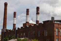Chimneys of the old plant. Plant shop of red brick