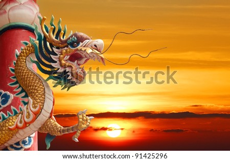 Chinese golden dragon with column and sunset background