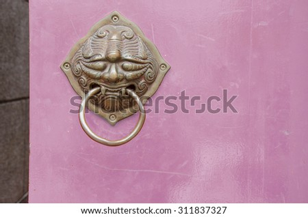 chinese,purple wood door  metal knocker lion handle, decoration of temple #311837327