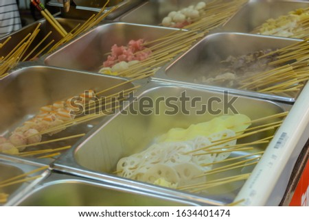 Chinese street food. Street trading. Chinese kinds of fresh seafood at an asian seafood market in Sanya, Hainan province, China. Inscription: name food.