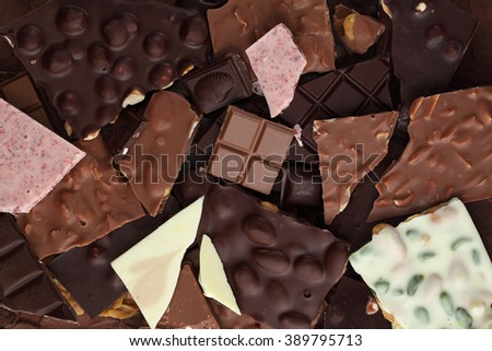 Chocolate bar/ chocolate bar pieces / nut chocolate/ chocolate background #389795713