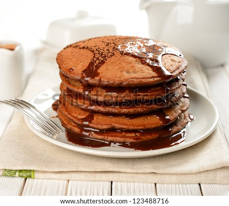 Chocolate pancakes with chocolate sauce