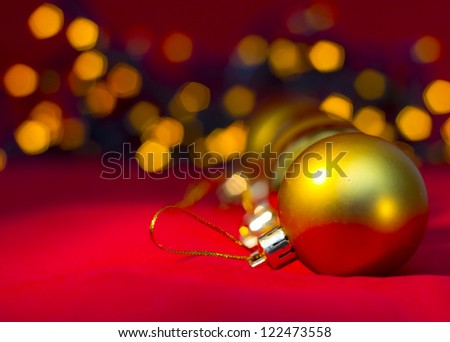 2013 Christmas  and New Year Decoration. Gold  baubles reflected on the red background - stock photo