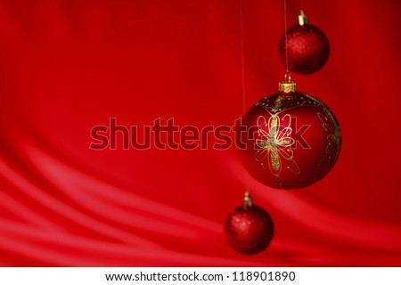 christmas balls on red satin background