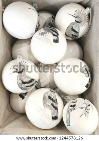2019. Christmas balls with pictures in the basket. Balls to decorate the tree. Design. Background #1244578126