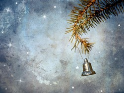 Christmas card featuring a little silver bell hanging from a pine branch with whimsical designs and copy space.  Grunge textured.