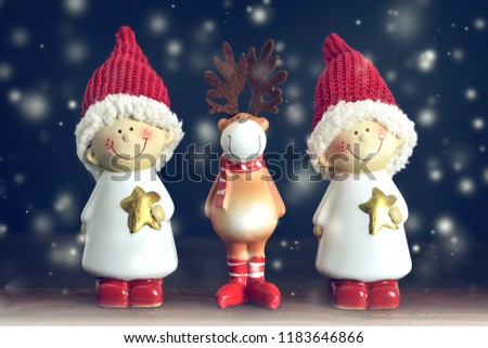Christmas card with Christmas reindeer and elves #1183646866