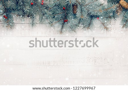 Christmas composition on a white wooden background. Copy space #1227699967