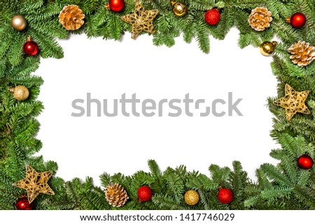 Christmas frame. Christmas card. New Year`s greetings. Frame with branches of a Christmas tree decorated with balls, toys and cookies #1417746029