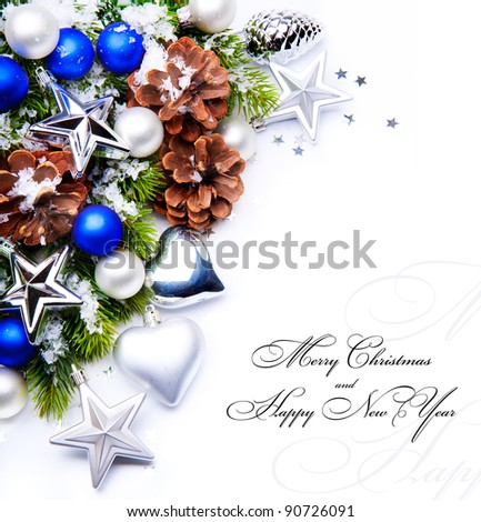 christmas frame with fir tree branch and christmas decoration  on white background