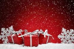 Christmas gift box on snow.