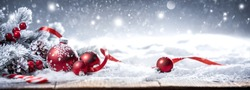 Christmas Holiday Background with Red Bauble on Snow