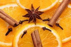 Christmas spices for mulled wine. Orange, cinnamon, cloves, star anise. Close up