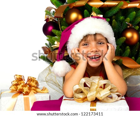 Christmas tree and Pretty little girl smiling with present