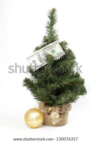 Christmas Tree with ornaments and dollars on white background