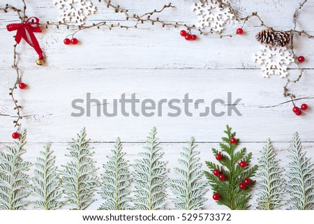 Christmas wooden background with the symbol of the Christmas tree and red viburnum berries