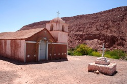 church built of earth and stone in the middle of the atacama desert in chile