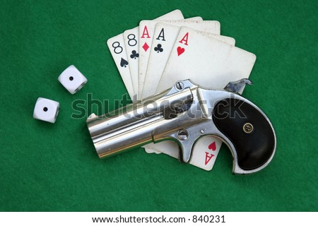 """Circa 1889, Model 95, Type II Model 3 Double Derringer� lays ontop of Aces and Eights with shells and snake eyes dice"