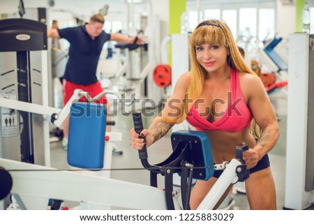 Classic bodybuilding  Muscular blonde woman doing exercises