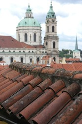 clay roof tiles, background of the domes of baroque, churches, inspiring citycsape view of great city Prague