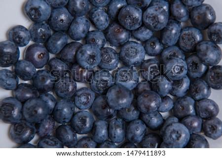 Clean freshly picked blueberries - close up studio shot. ( Ingredients:  Antioxidants , Vitamin C, Antioxidant)