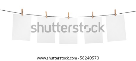 5 clean sheets on clothesline with clothespins isolated on white background