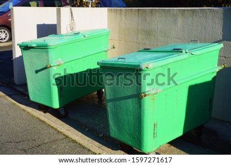 2 cleaned trash cans in the housing complex