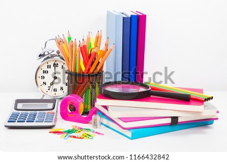 Close shots of table bright stationery objects.