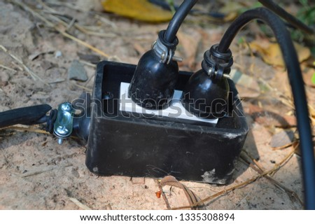 Close-up, black power plug on the ground, plug-in extension cord, plug On the ground background. #1335308894