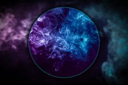 Close-up dense multicolored smoke of   blue and purple colors    blown under a magnifying glass on a black isolated background. Background of smoke vape
