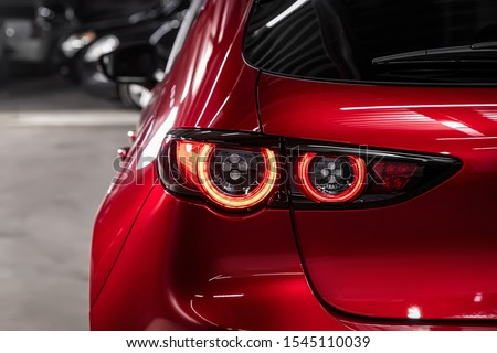 Close up detail on one of the LED red taillight modern red crossover car. Exterior detail automobile. Stockfoto ©