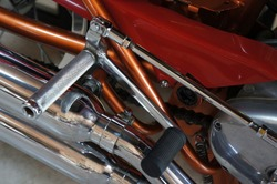 Close up Foot pegs and Gear shift linkage of Motorcycle vintage style