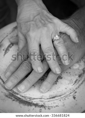Close Up of a Senior Couple's Embracing Hands #336681824