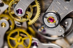 Close-up of balance ruby jewel, shock resistant spring, regulator and balance wheels. Mechanical spring driven watch.