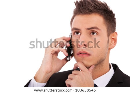 Close up of business man on the phone looking to the side against a white background