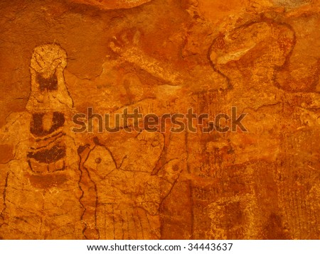 Close up of pictographs painted on cave wall by prehistoric Native American(s), possibly thousands of years old. Remote cave inside Grand Canyon National Park, Arizona, USA.