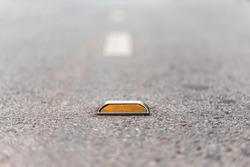 Close up of reflector on  asphalt road