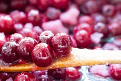 Close up of simmering homemade cherry jam. Cherry and sugar crystal.Cooking Homemade Cherry Jam. Close-up.