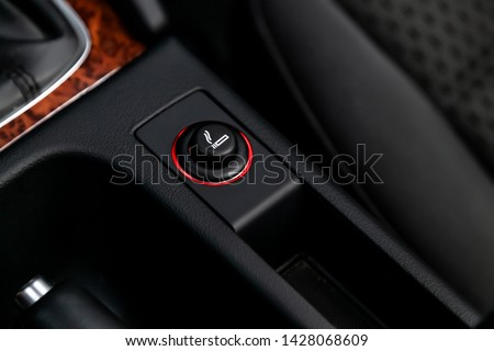 Close up of the car cigarette lighter socket.modern car interior: parts, buttons, knobs