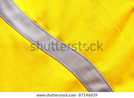 Close up of yellow polyester nylon yellow sportswear shorts to created a textured background.