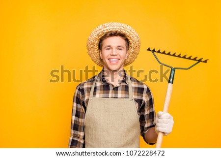 Close up portrait of glad confident excited cheerful rejoicing gardener using hand tool for getting rid of leaves isolated  on background copy-space