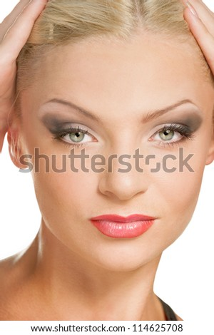 Close-up portrait of young beautiful woman on white background